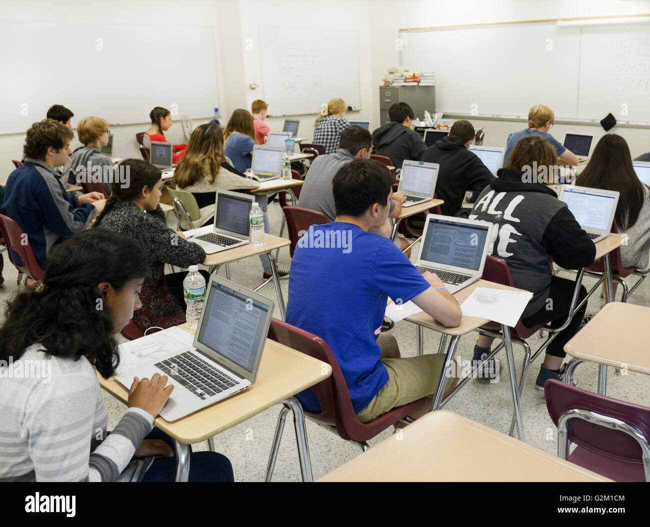 Students taking a test on laptops in a high school classroom. The test is the national PARCC test - Stock Image