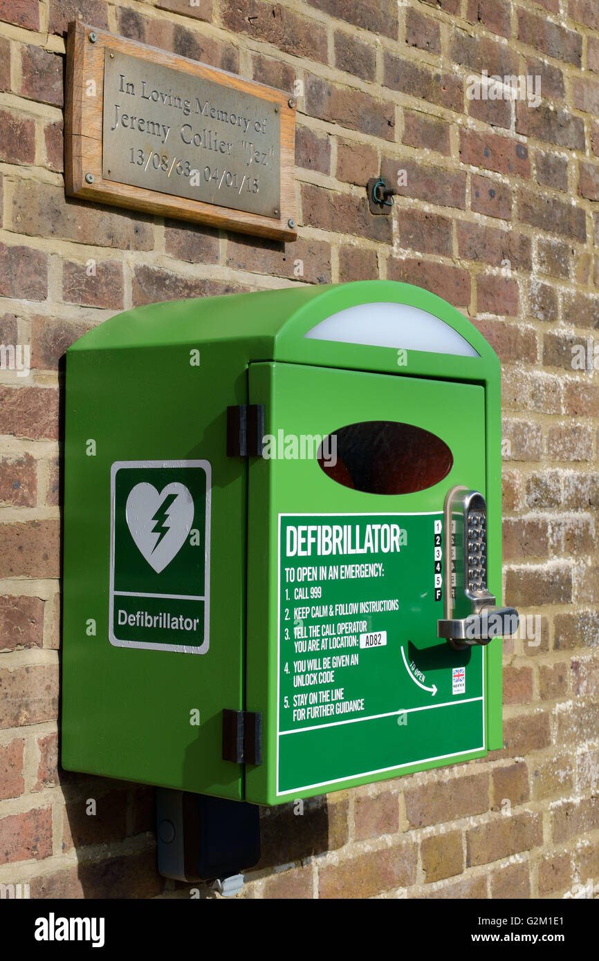 Wall Mounted Emergency Defibrillator in Village Stock Photo