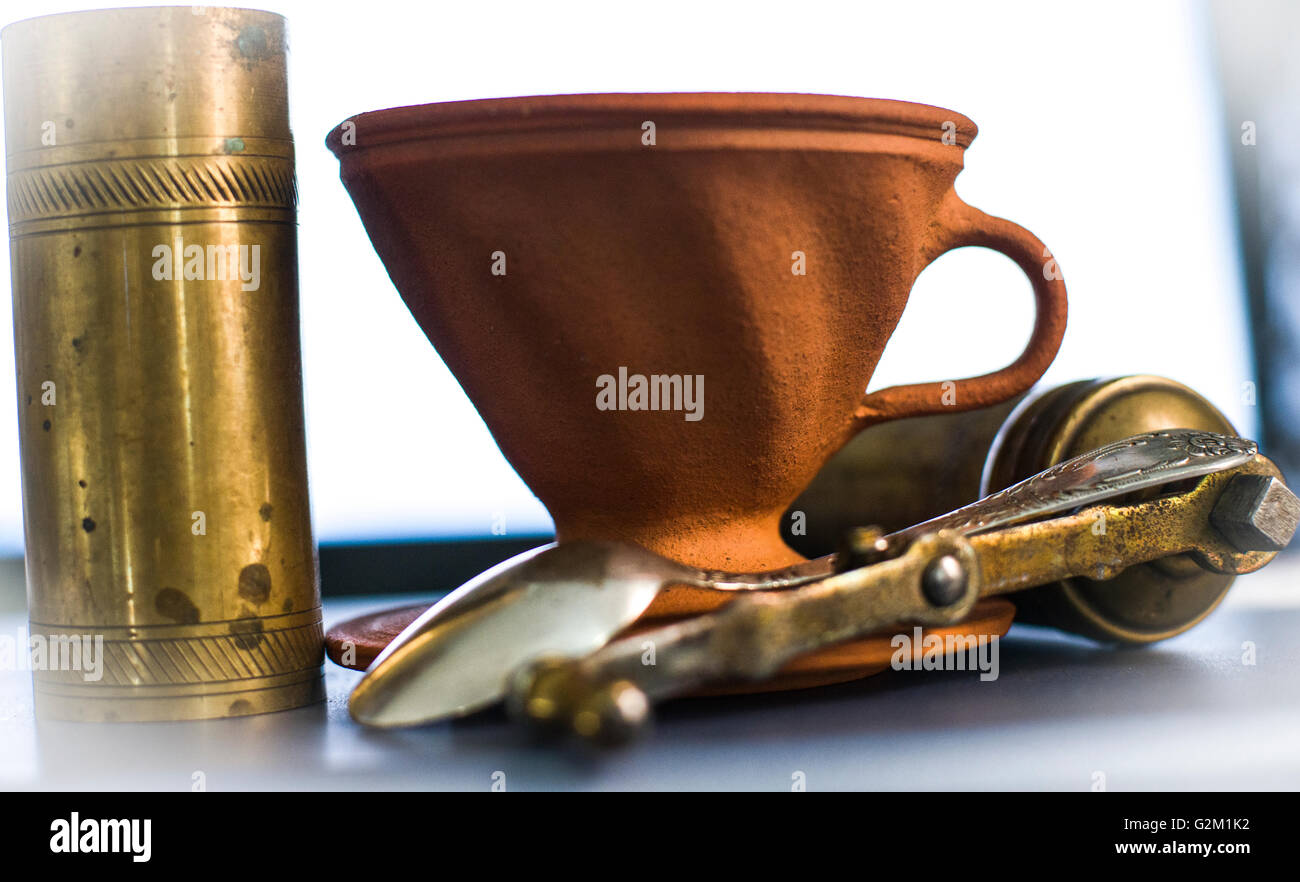 Coffee brewing set -  ceramic pourover (dripper) and ancient grinder - Stock Image