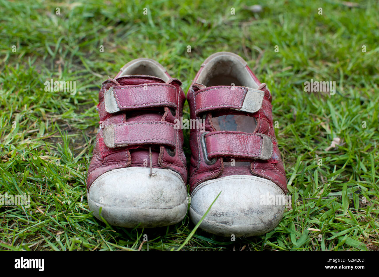 children's shoes on grass - Stock Image