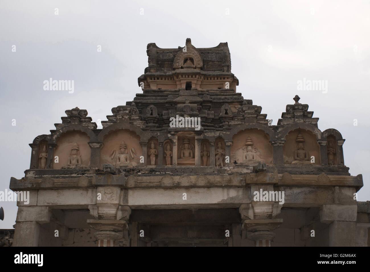 Carved figures at the top of the entrance, Gomateshwara temple, Vindhyagiri Hill, Shravanbelgola, Karnataka, India. Stock Photo