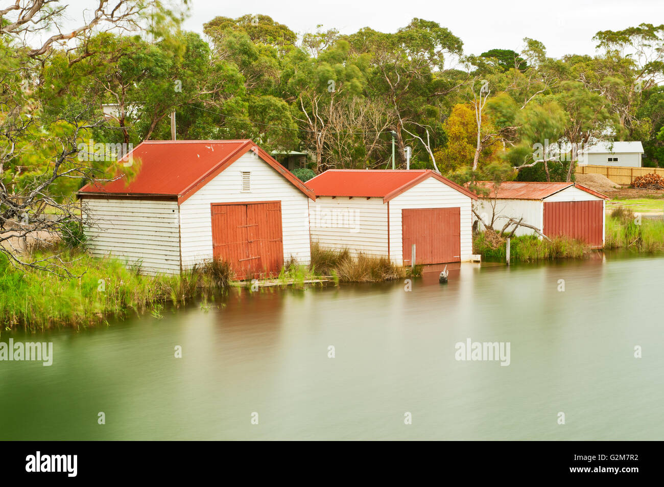 Boatsheds at Anglesea River on the Great Ocean Road. - Stock Image