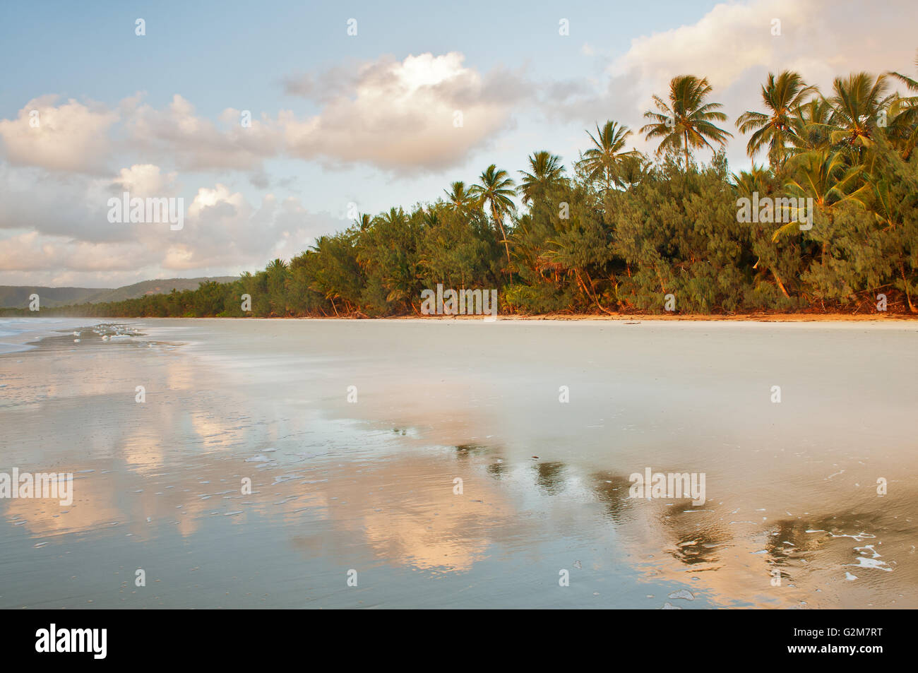 Early morning reflections on Four Mile Beach in Port Douglas. - Stock Image