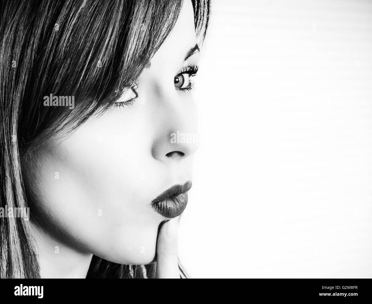 Black and White Portrait of a Young Woman Considering Choices or Options For Her Future - Stock Image