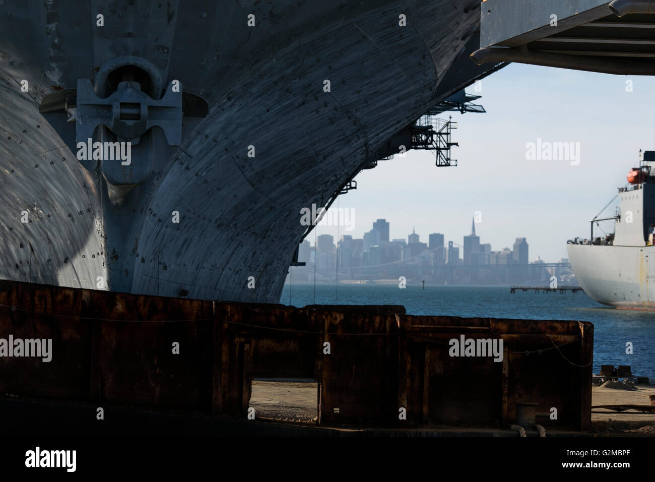Looking at San Francisco Bay and the city and in the foreground is the hull of the Aircraft Carrier, The USS Hornet, - Stock Image