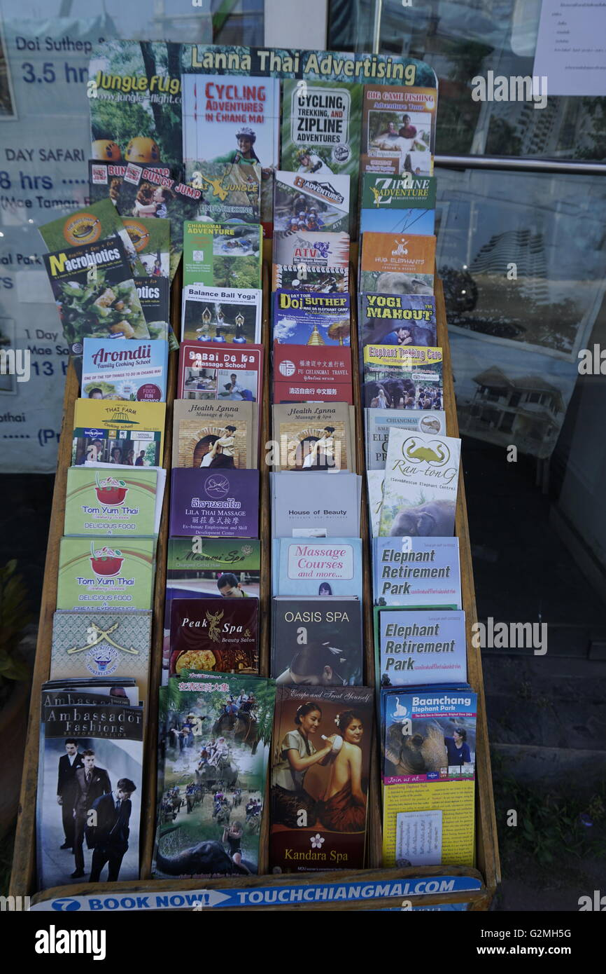 brochures for tourist and leisure activities in Chiang Mai, Thailand - Stock Image