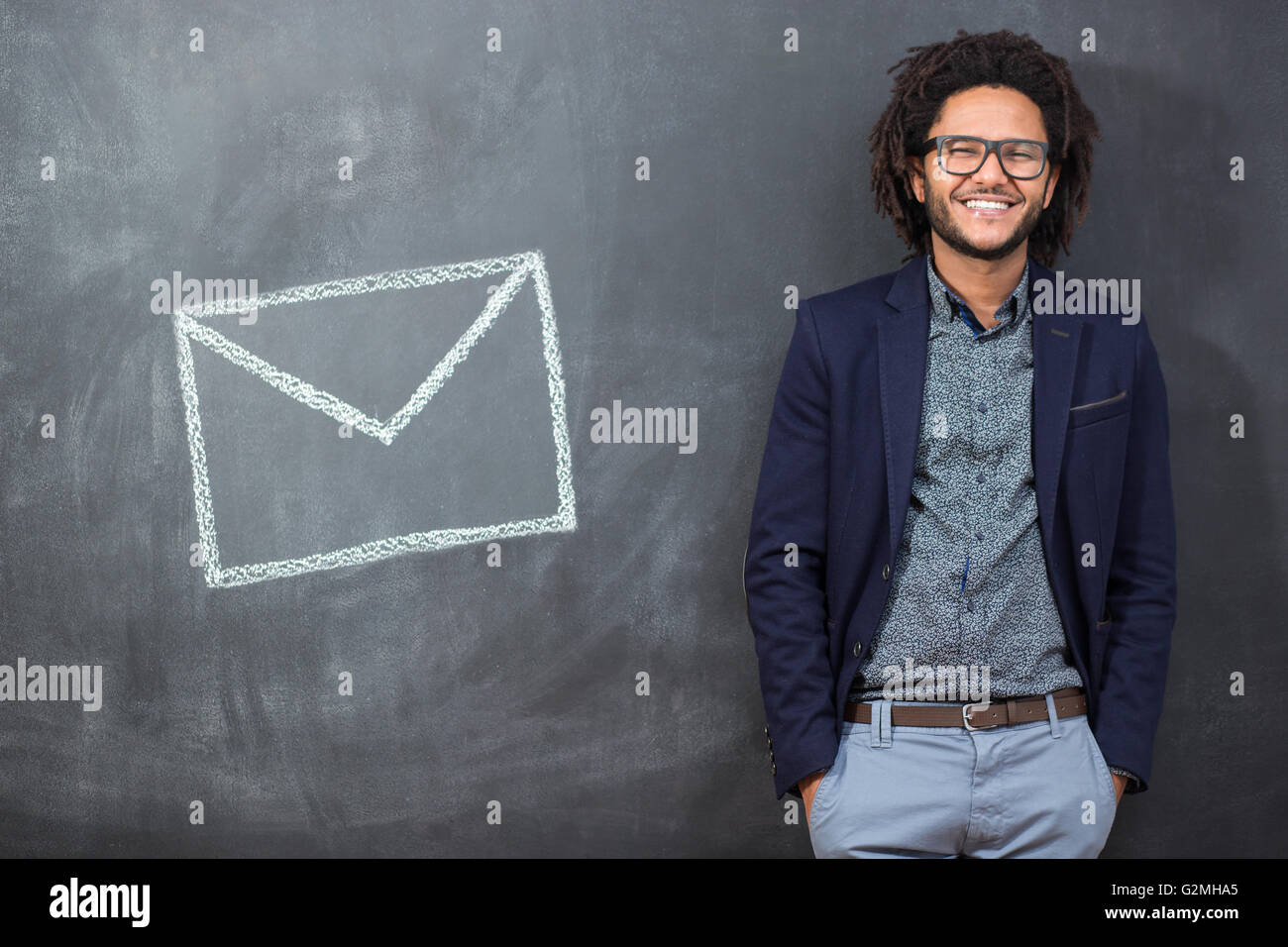 Closeup portrait stunned, surprised businessman in black glasses . electronic device and internet concept. - Stock Image