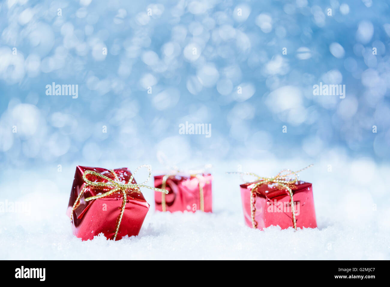 Red Gifts On A Snow With Blue Background For A Greeting Card Or