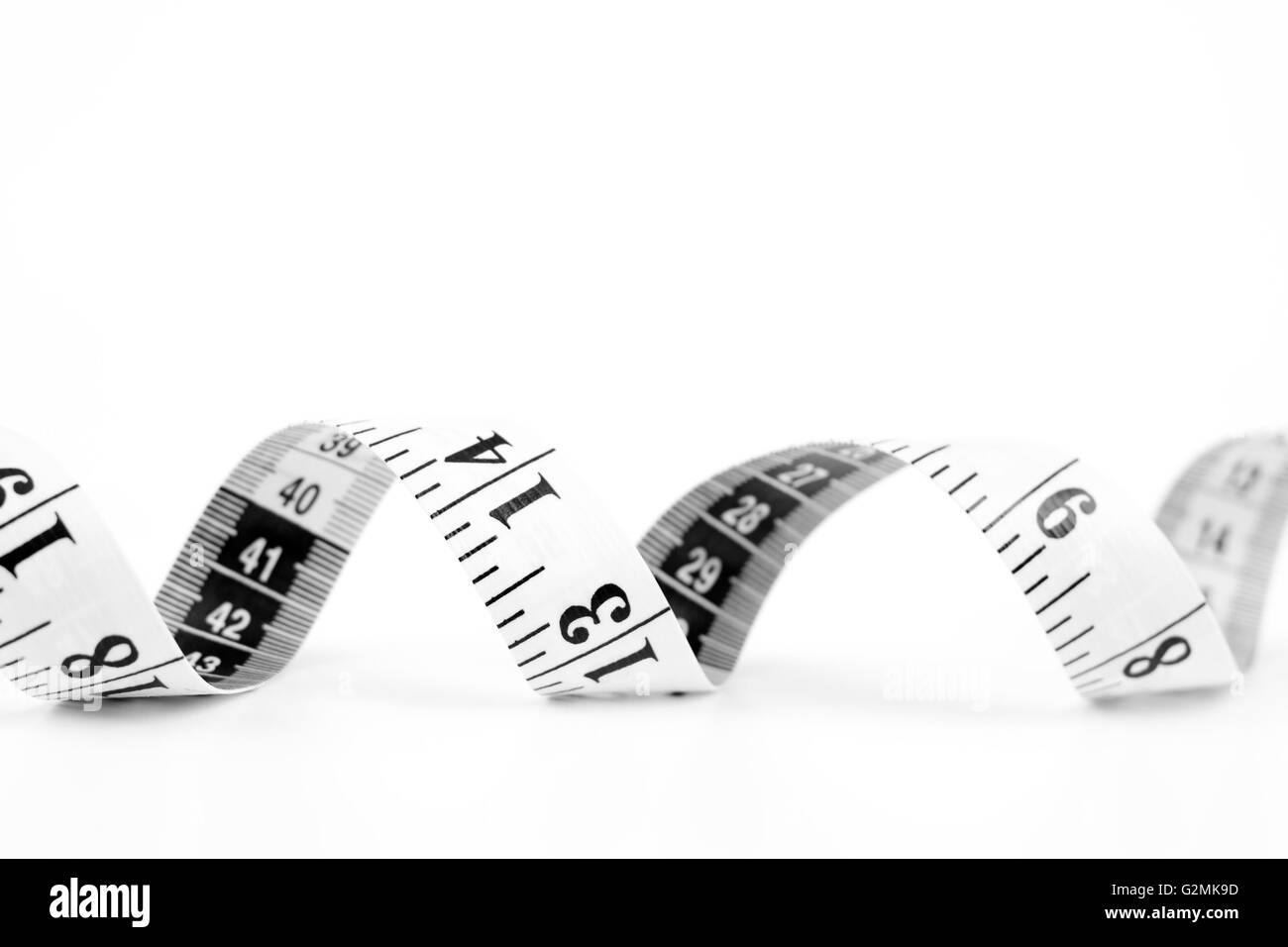 meter measuring tool white with black scale - Stock Image