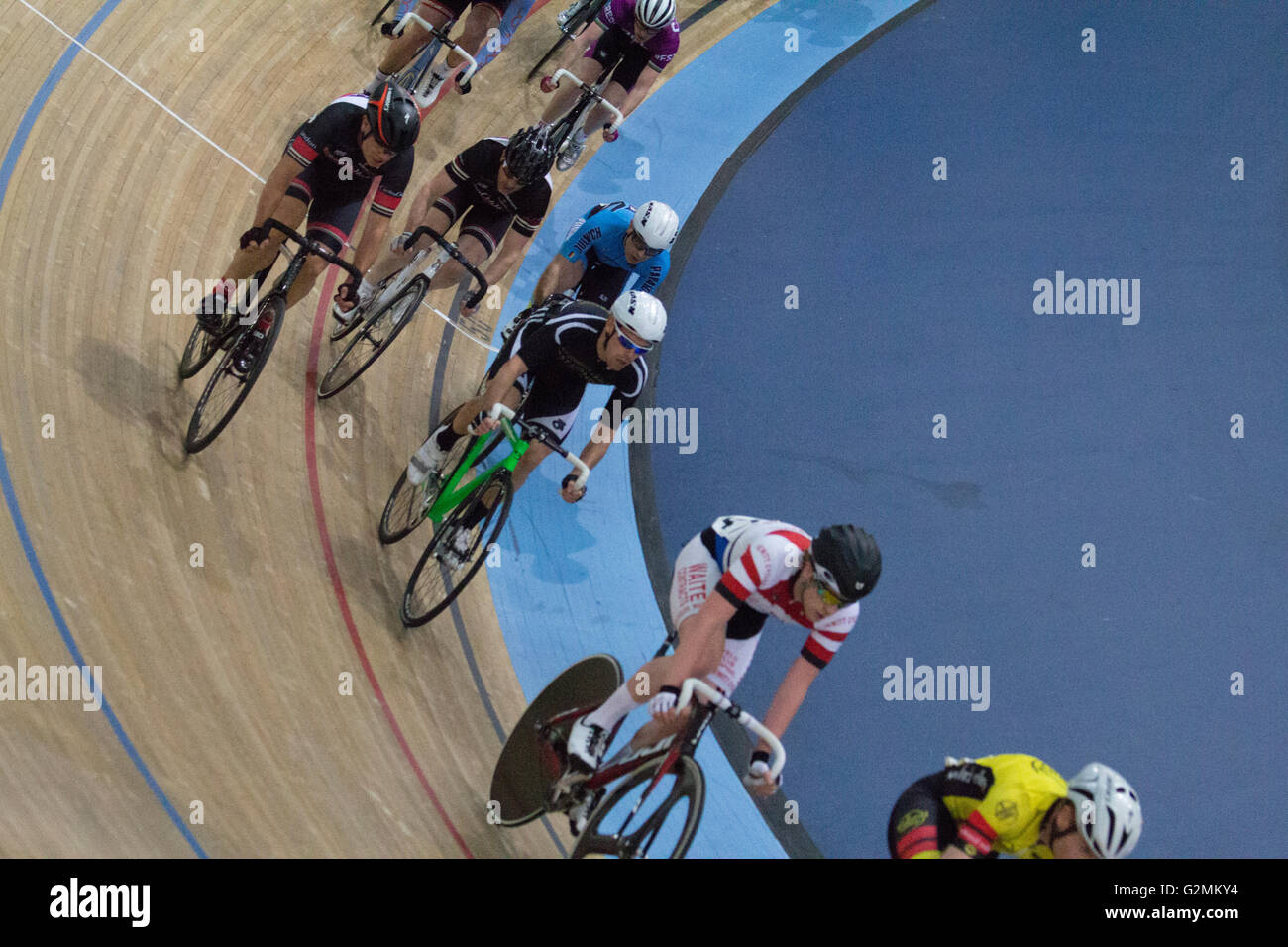 Interior of Lea Valley Lee Valley Olympic Velodrome, Stratford, London, with cycle race on wooden track - Stock Image