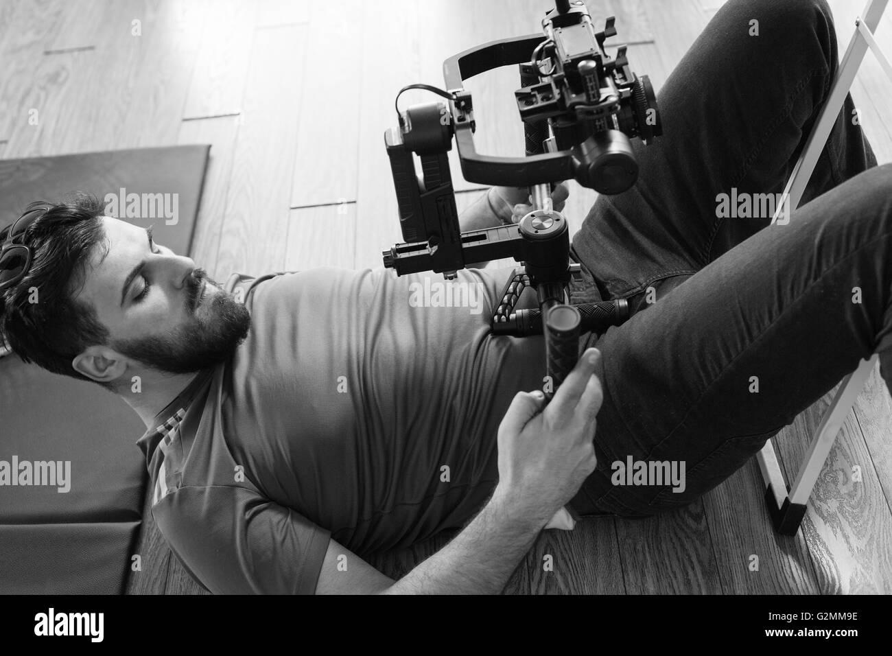 videographer with gimball video slr - Stock Image