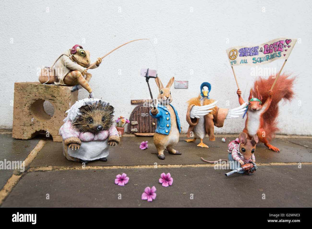 EDITORIAL USE ONLY (left to right) Miniature sculptures of Beatrix Potter characters Mr. Jeremy Fisher, Mrs. Tiggy - Stock Image
