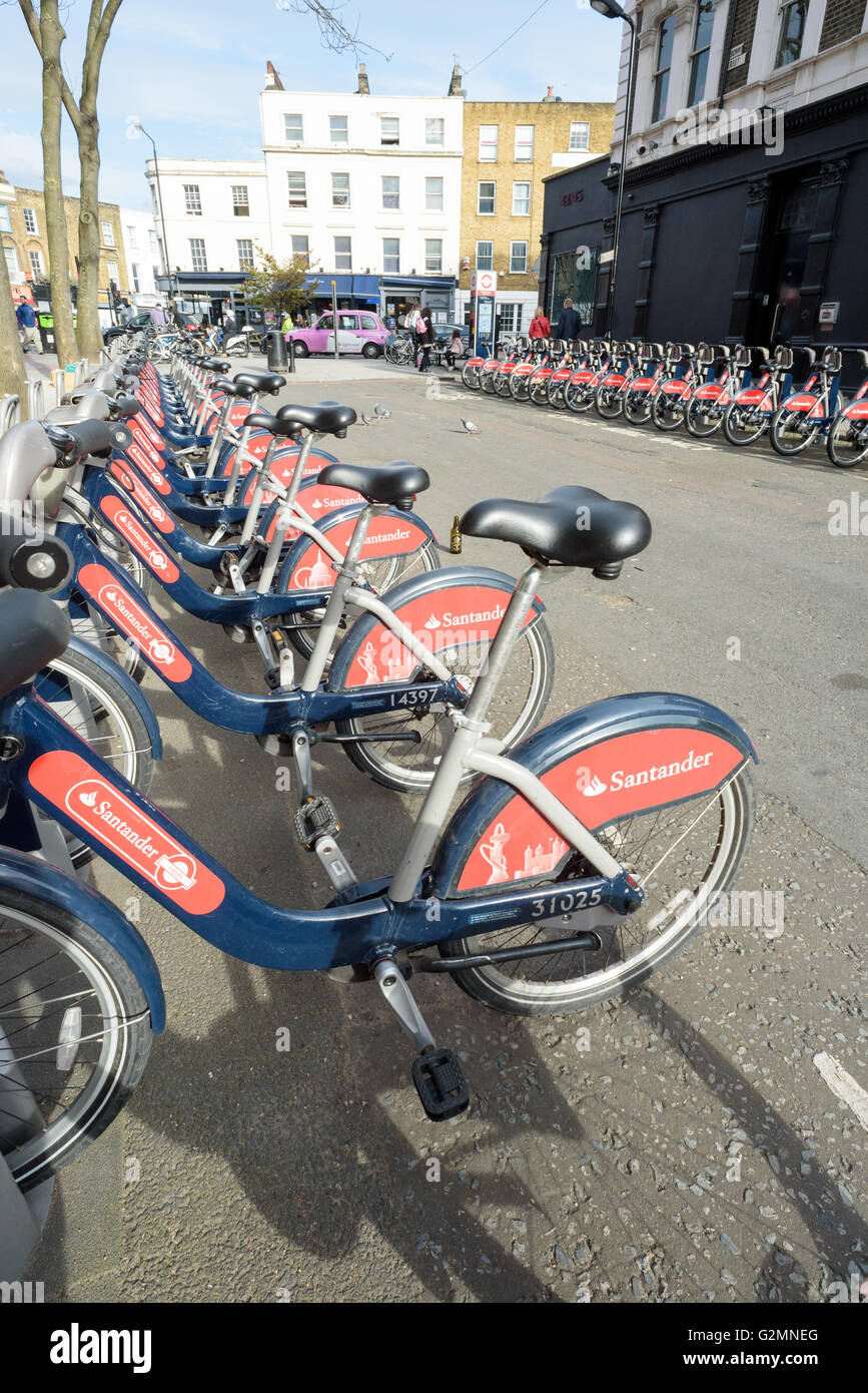 Hire bikes for traveling around the city of London sponsored by Santander offering cheap environmentally safe transport - Stock Image