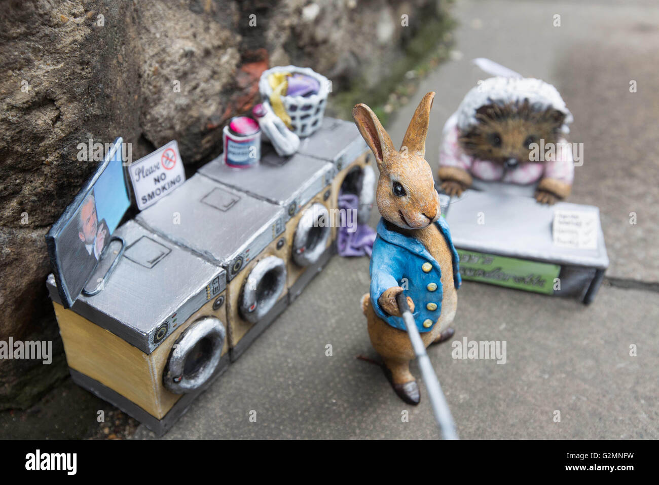 EDITORIAL USE ONLY Miniature sculptures of Beatrix Potter characters Mrs. Tiggy-Winkle and Peter Rabbit, which have - Stock Image