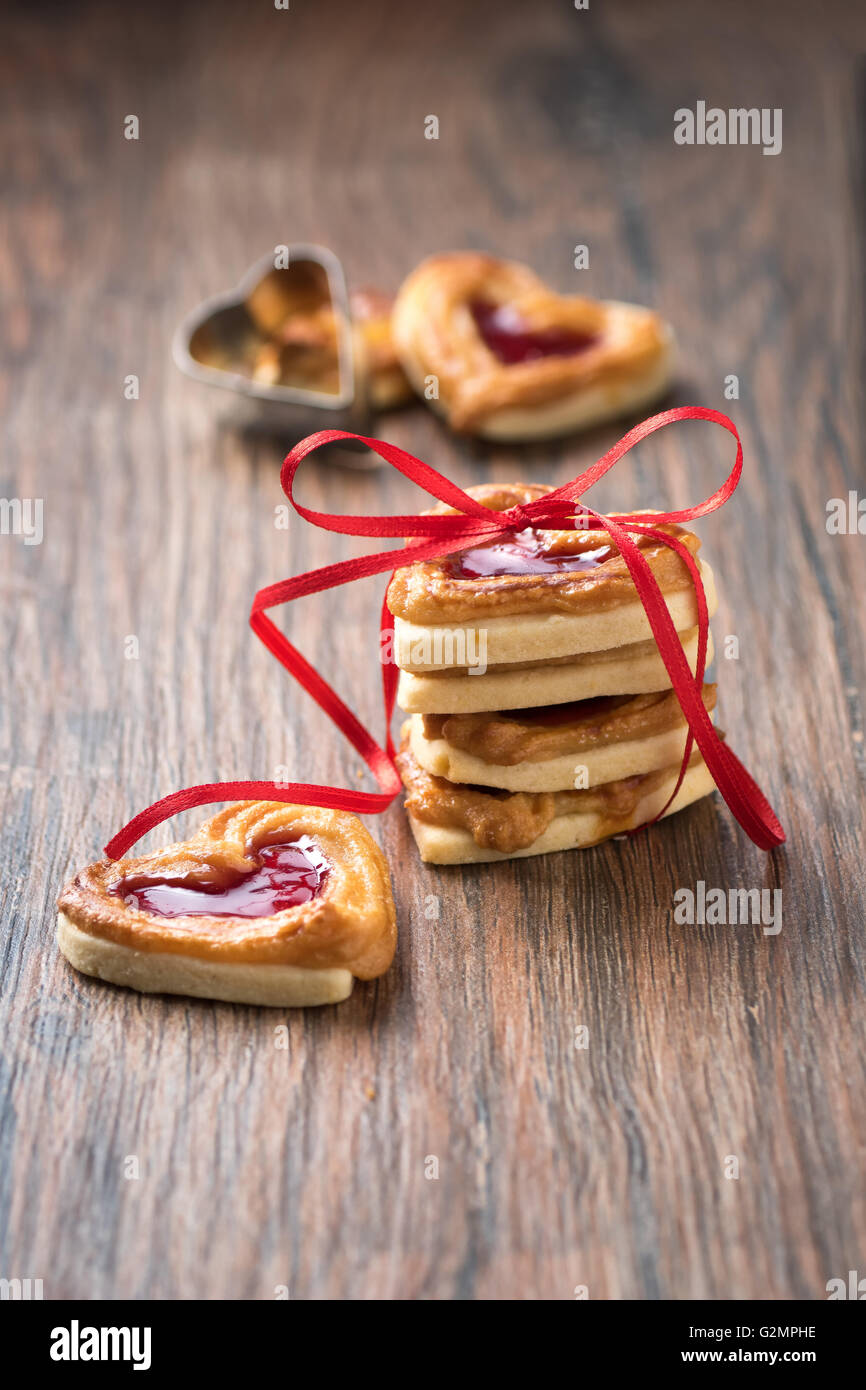 Fresh cookies with a bow on a wooden table. Use it for a card or recipe. - Stock Image