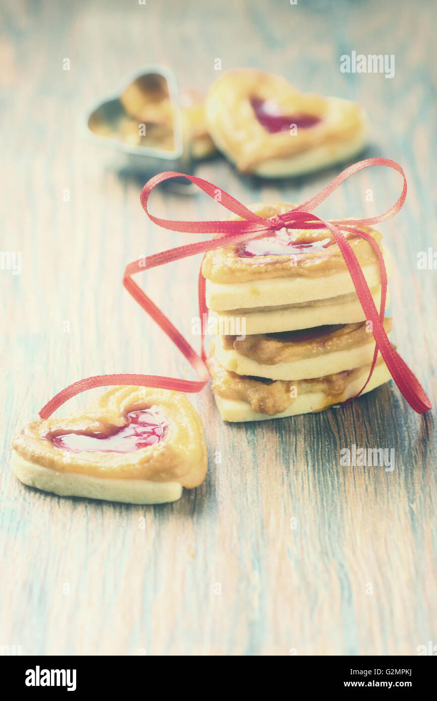 Cookies with marmalade in retro look. - Stock Image