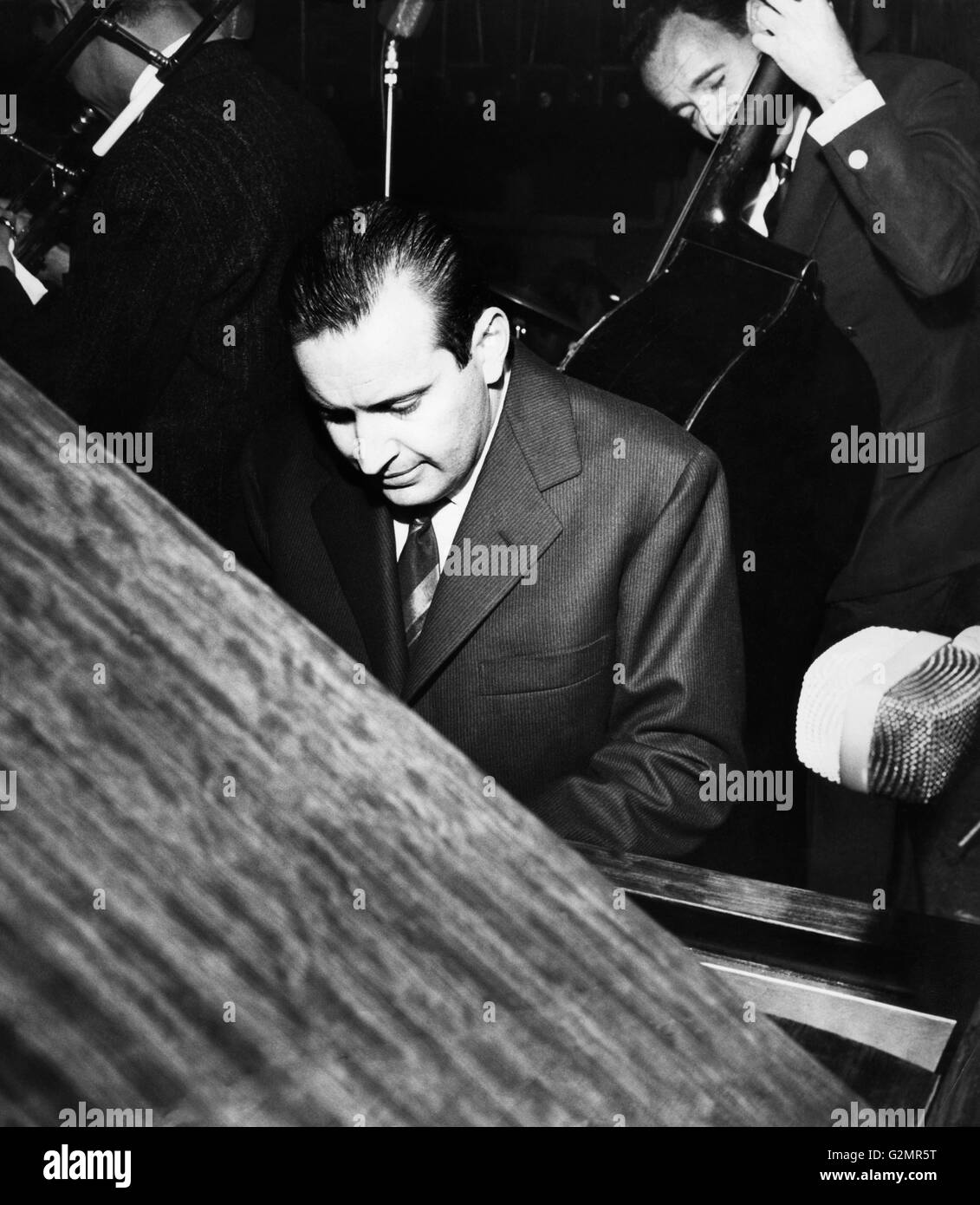 romano mussolini at the piano,1960 - Stock Image