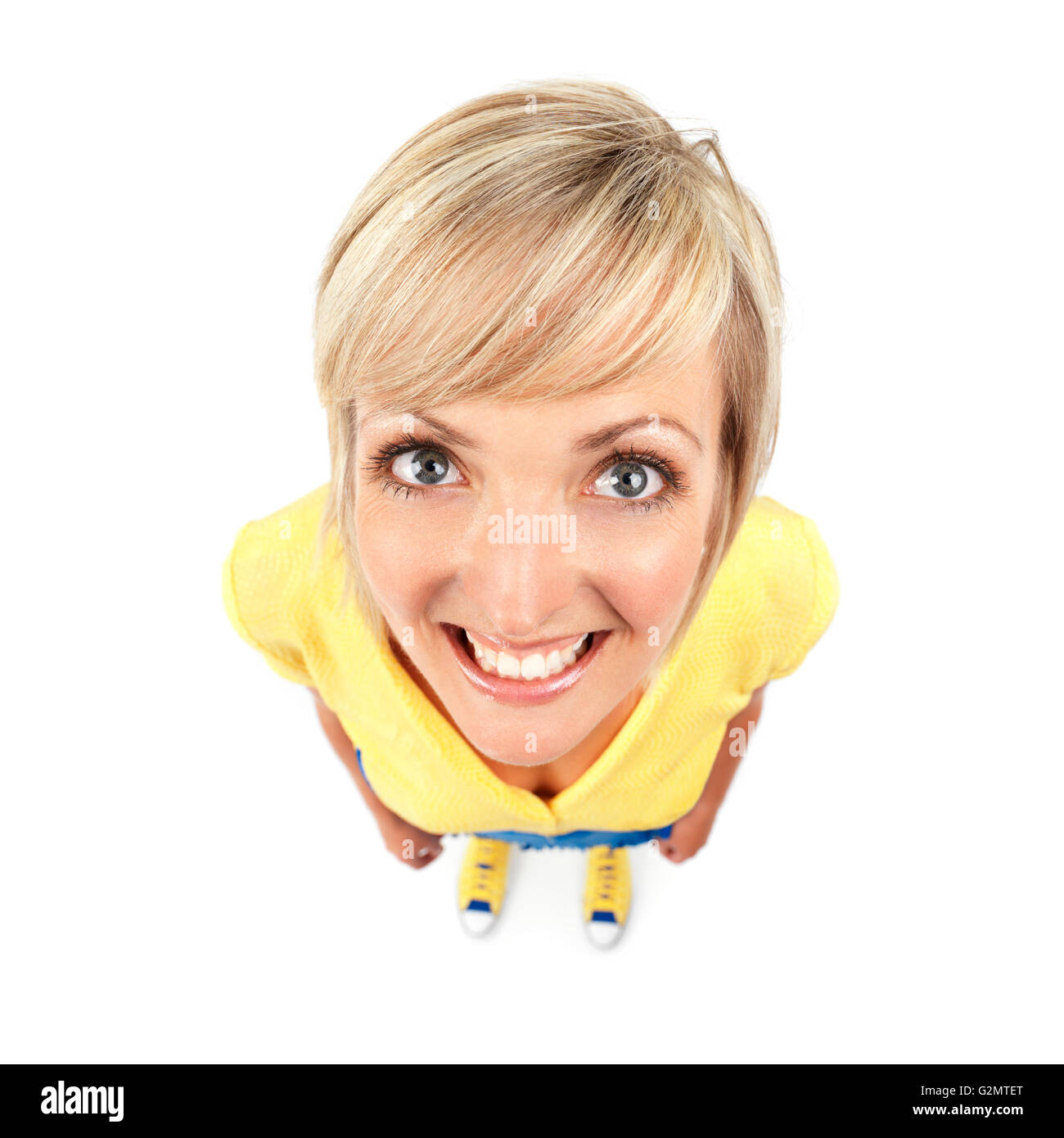 Smiling young woman, comical wide angle view - Stock Image
