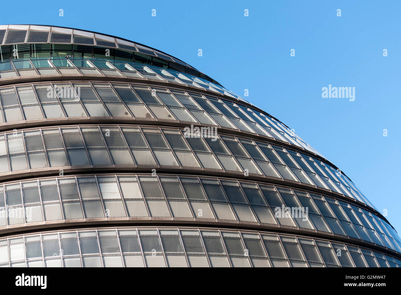 Facade of London City Hall, Greater London Authority or GLA Building, designed by Norman Foster, Southwark, London - Stock Image