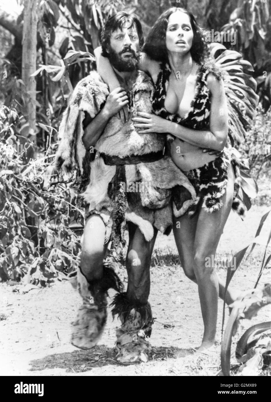 Ringo Starr,Barbara Bach in Caveman (1981) - Stock Image