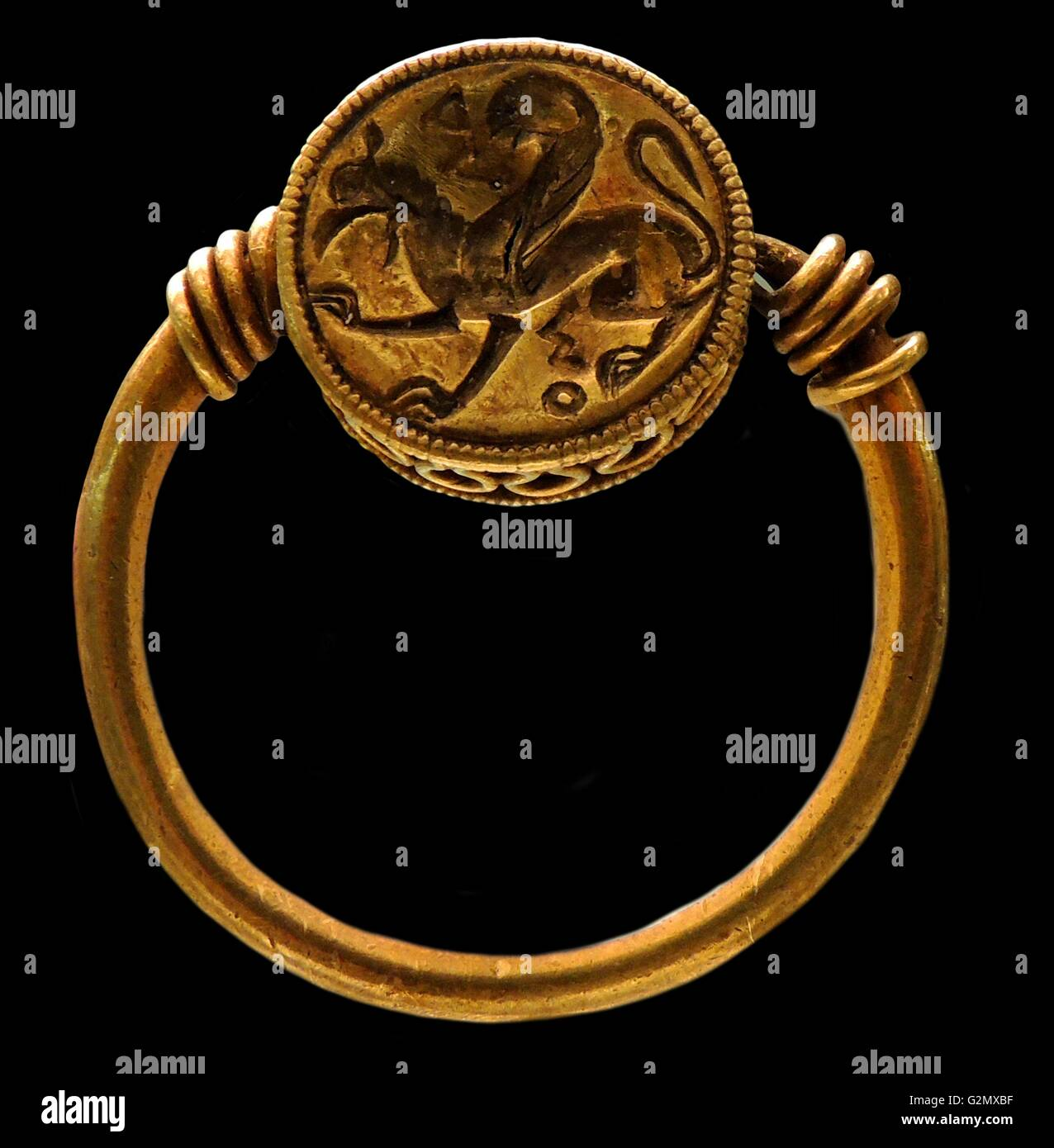 Gold ring engraved with a griffin 500 - 460 B.C. - Stock Image