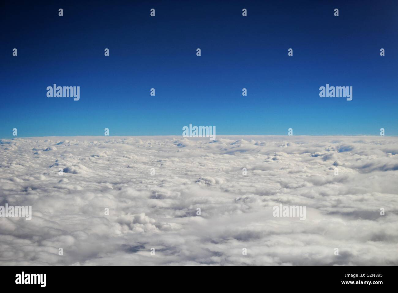 A fluffy flat cloud scene heading out to the horizon. - Stock Image
