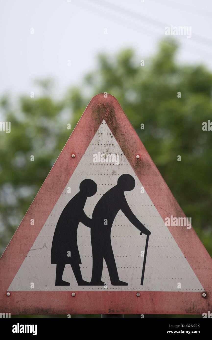 Elderly people warning sign. - Stock Image