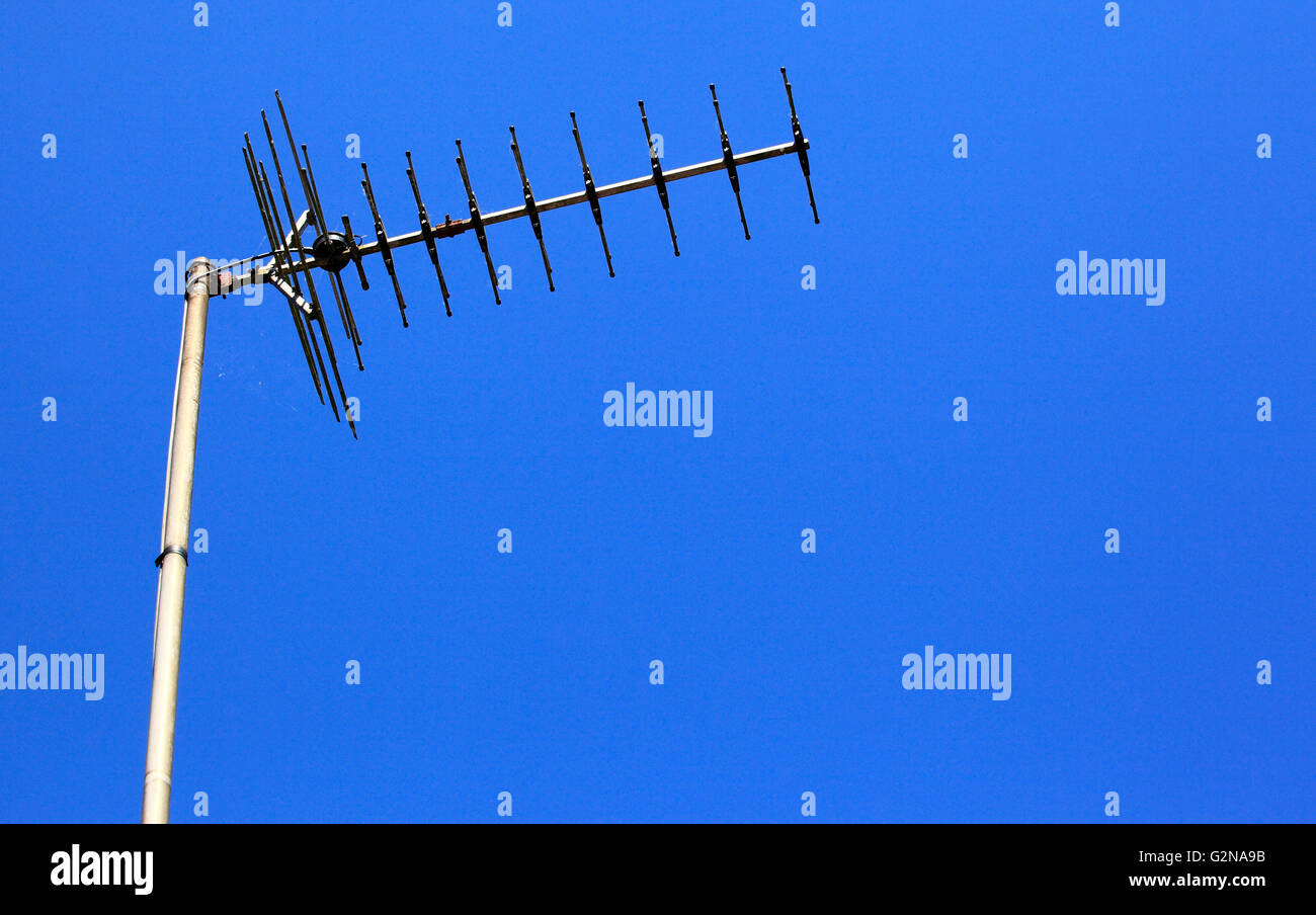 Domestic television aerial against a deep blue sky, Worcestershire, England, Europe - Stock Image