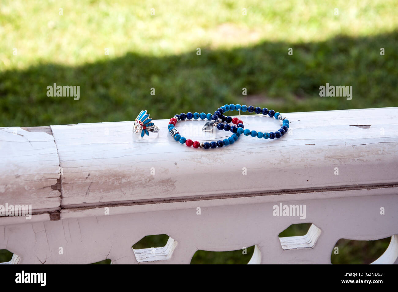 silver ring and bead bracelets on the wood - Stock Image