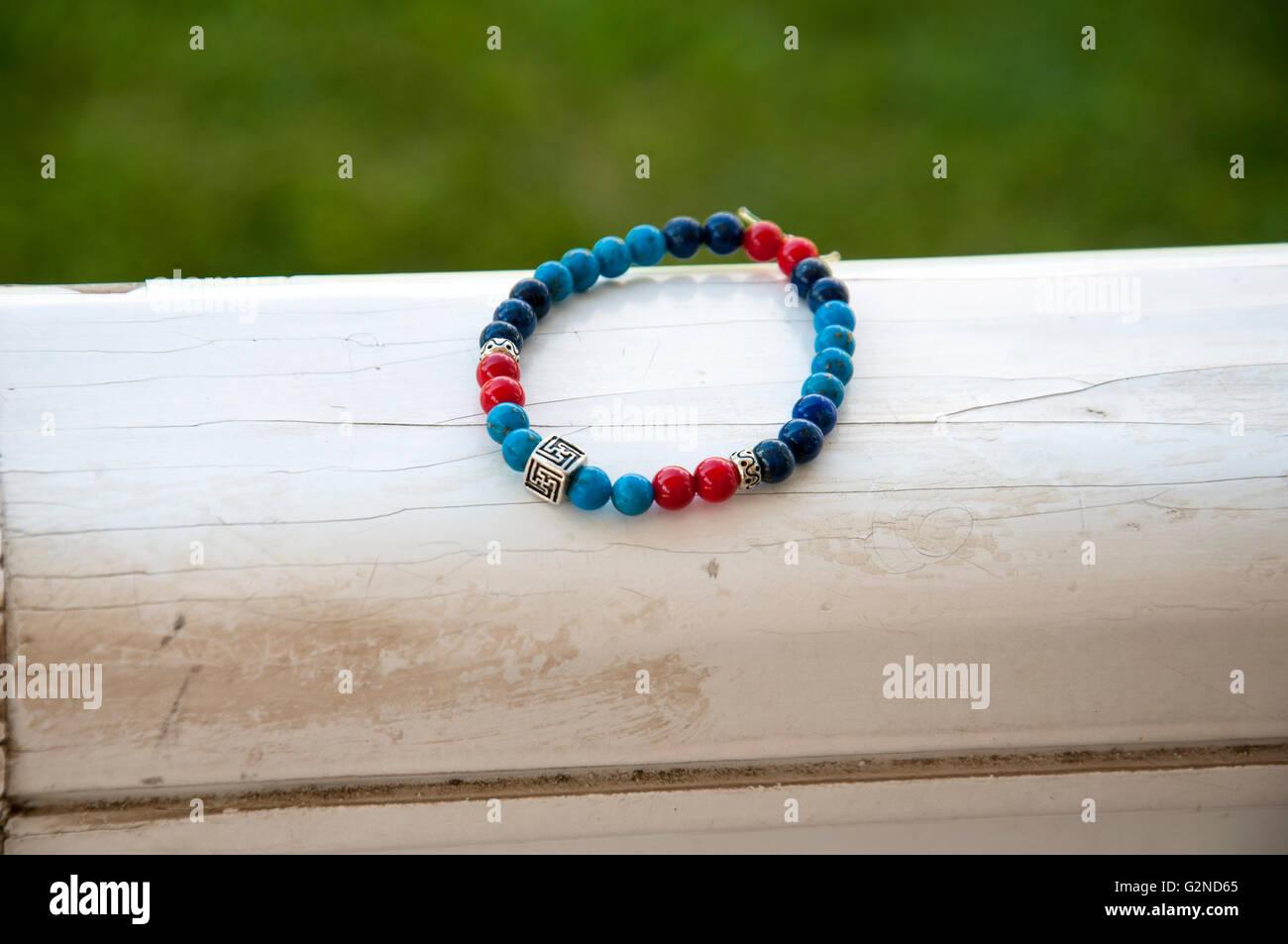 bead bracelet on the wood - Stock Image