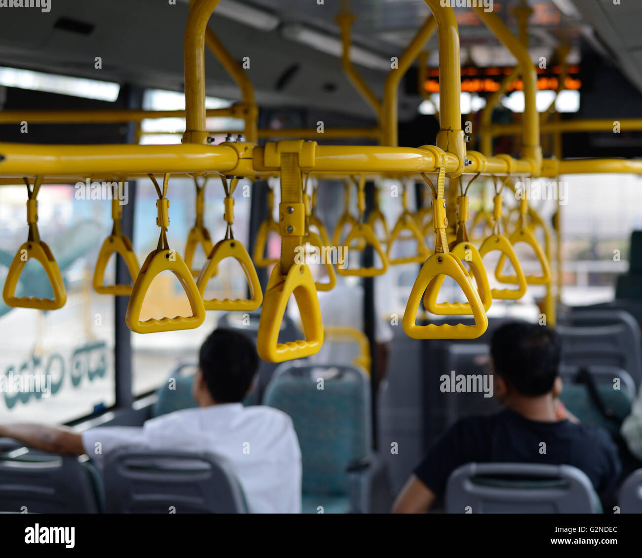 Straps to  hold to maintain balance in a commuter bus - Stock Image