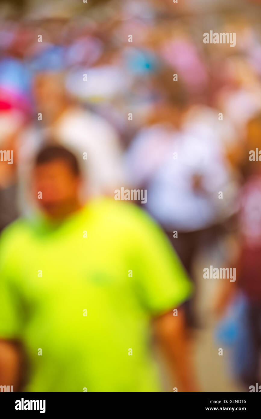People out of focus on the street, unrecognizable everyday ordinary people in public place - Stock Image