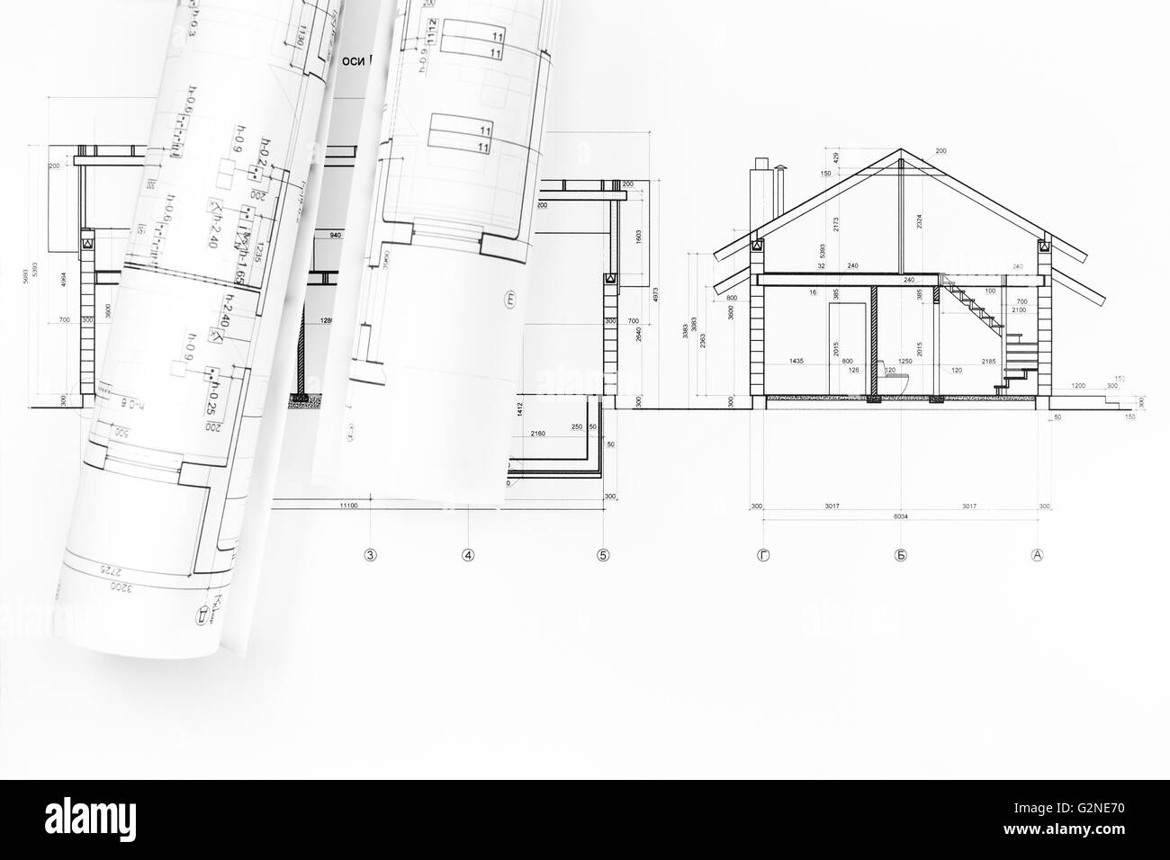 Rolls Of Blueprints And Architectural Drawings Of The Modern House