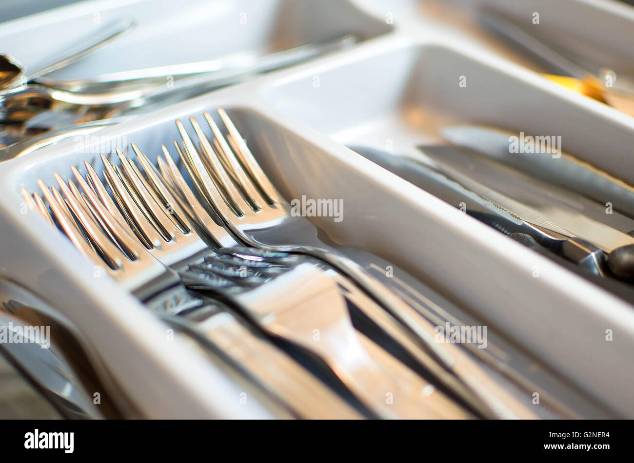forks closeup cutlery drawer - Stock Image