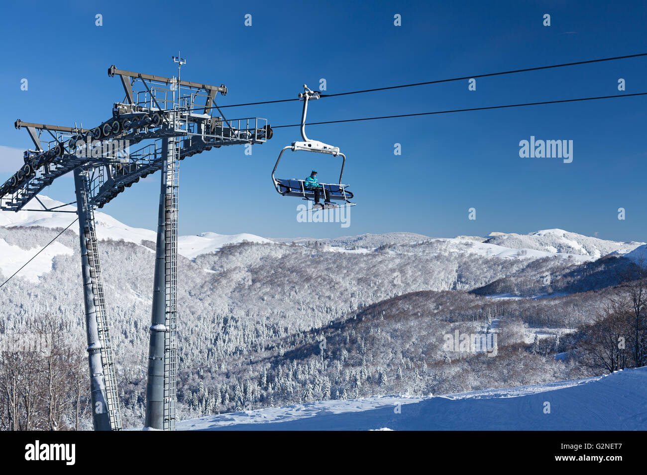 Ski lift with seats going over the mountain Stock Photo: 104964167 ...