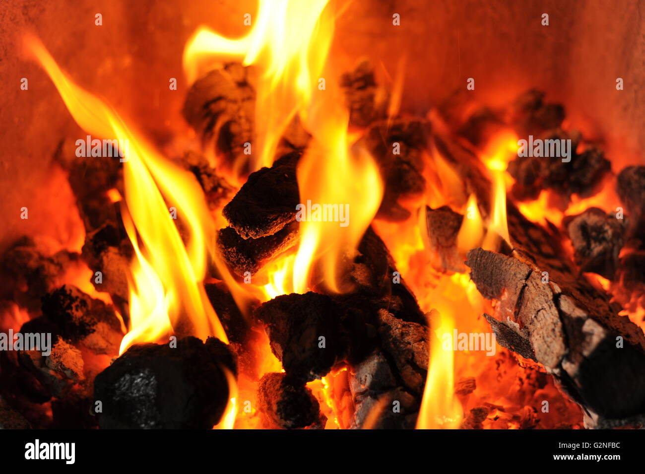 coals burning in a fire place - Stock Image