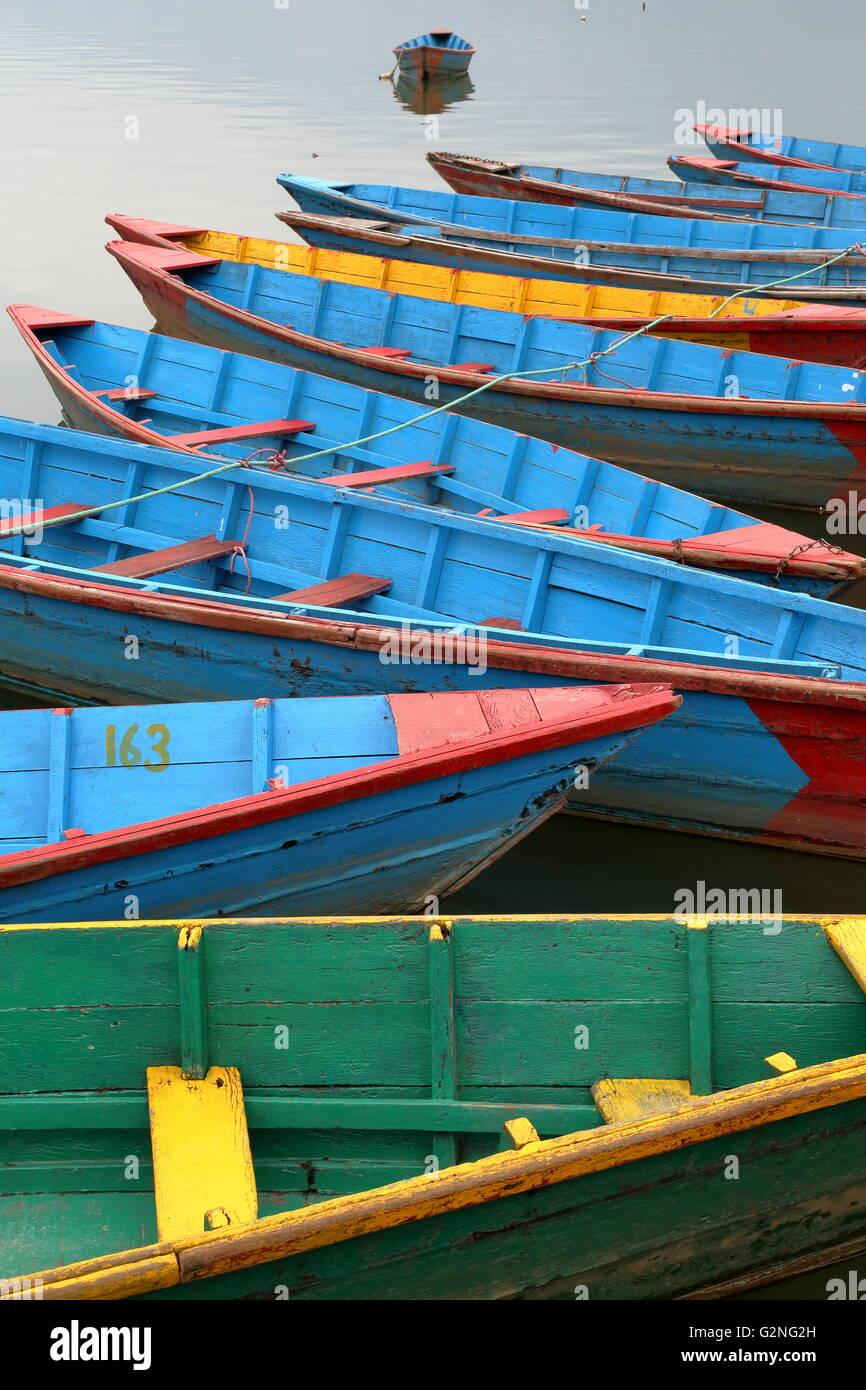 Colourful rowing boats on the Phewa Lake, Pokhara, Nepal - Stock Image