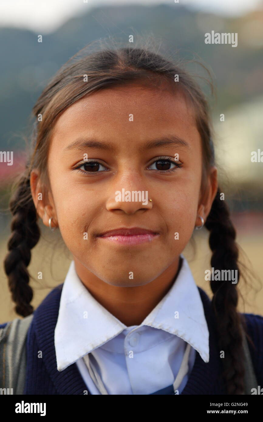 Portrait of a school girl in Pokhara, Nepal - Stock Image