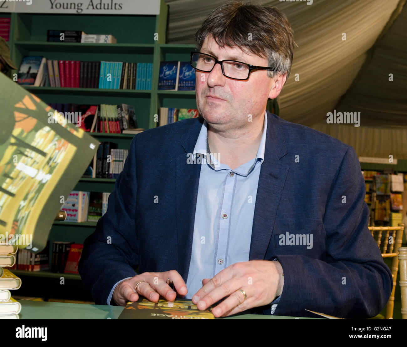 Simon Armitage, poet, Oxford Professor of Poetry, book signing his new work Pearl at Hay Festival Saturday 28th - Stock Image