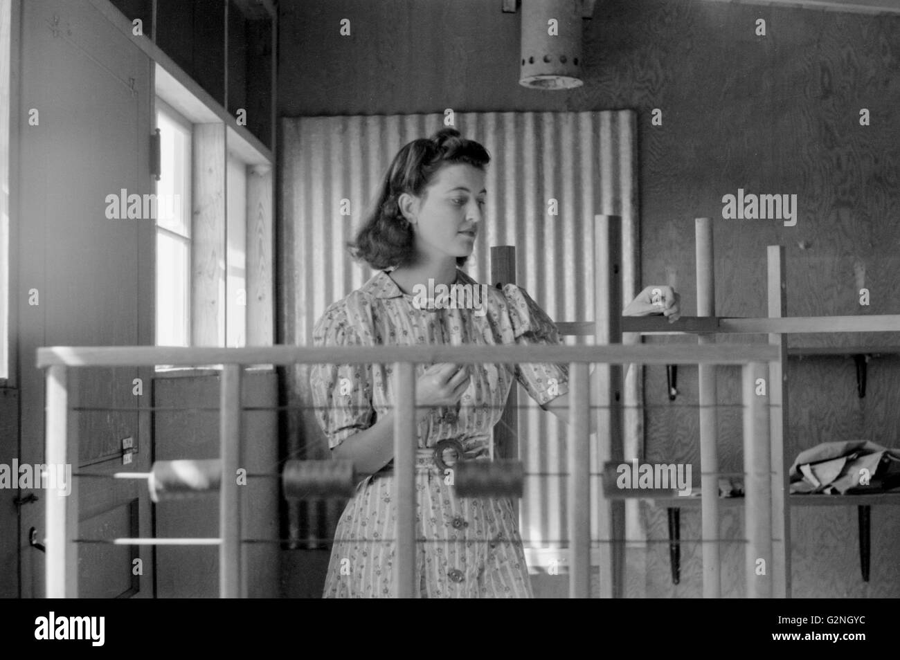 Woman Working in Weaving Shop, Farm Security Administration (FSA) Camp, Sinton, Texas, USA, Arthur Rothstein for - Stock Image