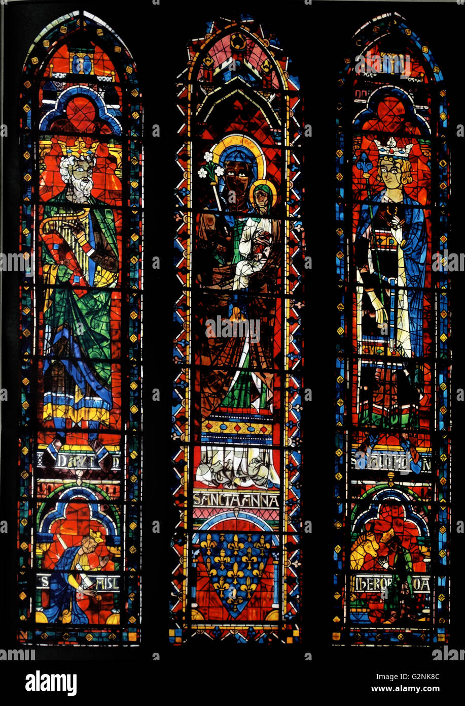Stained glass windows from the North Transept of Chartres Cathedral, France. Shows King David with harp; St Anne Stock Photo