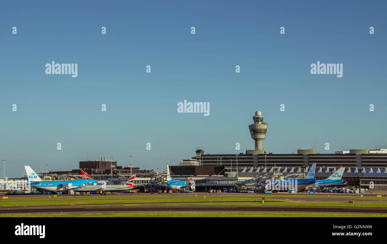 KLM plane being loaded at Schiphol Airport. There are 163 destinations served by KLM - Stock Image