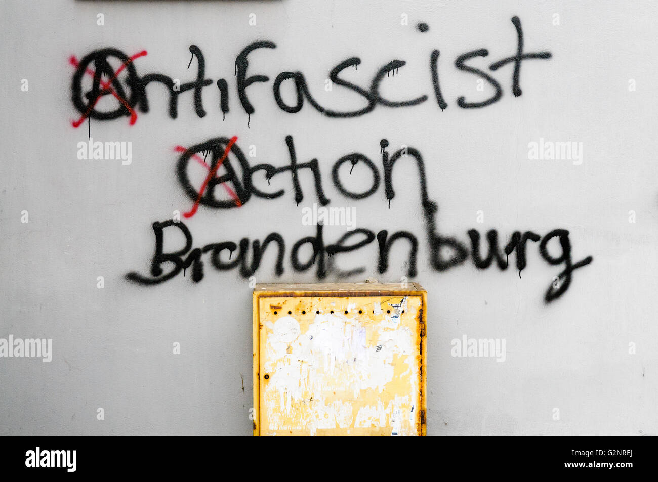 Graffiti on a wall saying 'Antifascist Action Brandenburg' - Stock Image