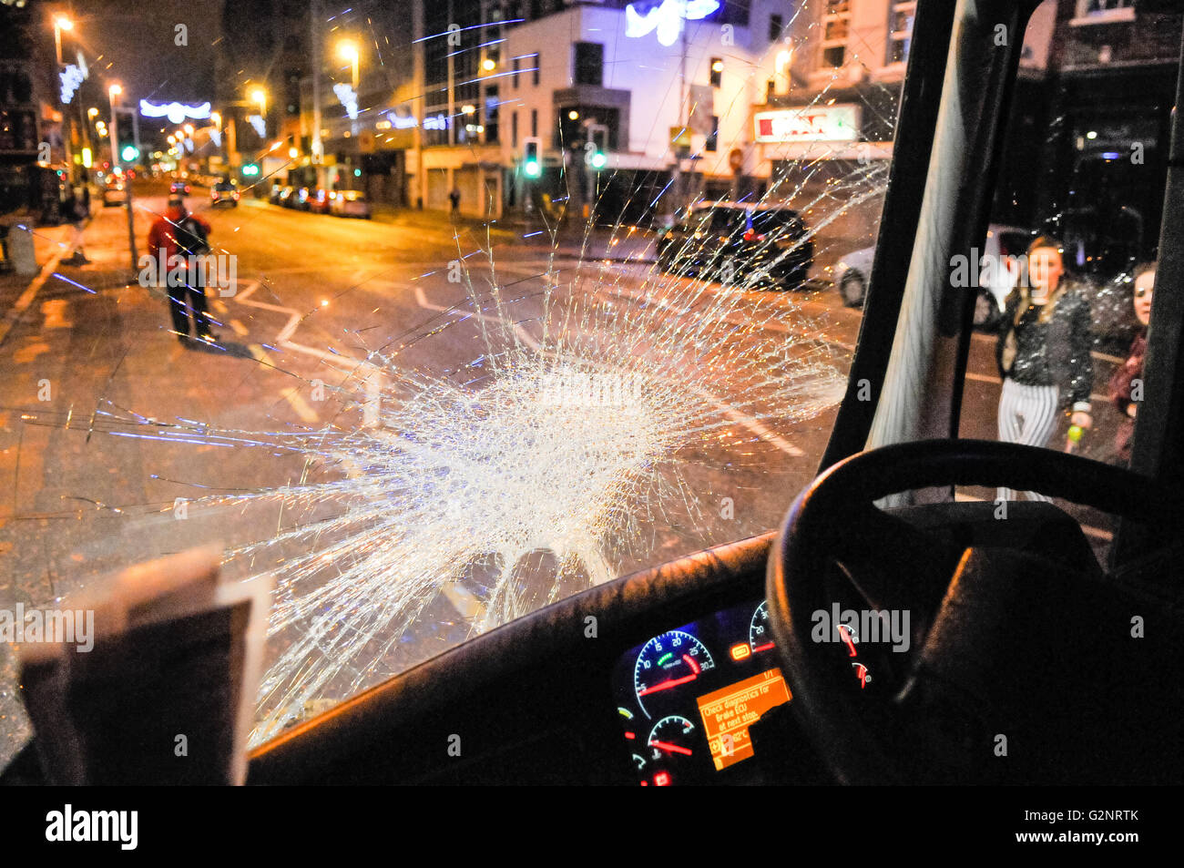 3rd December 2012, Belfast, Northern Ireland. A bus suffers a broken windscreen after a number of rioting loyalists - Stock Image