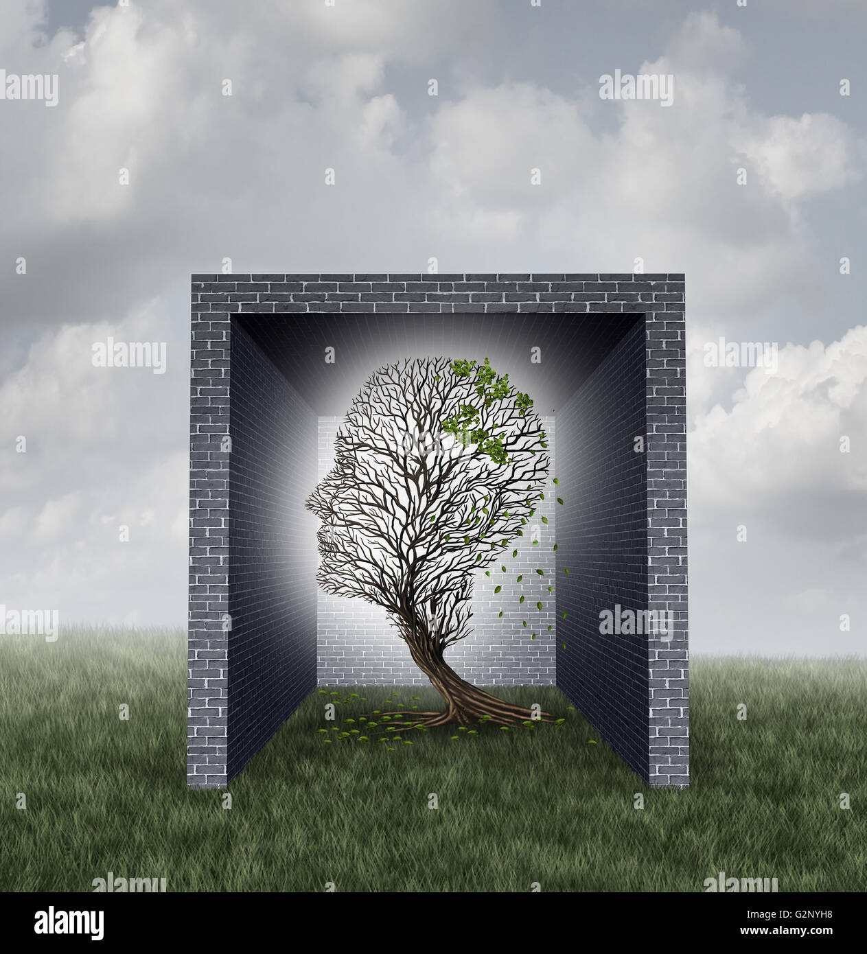 Emotional walls psychological concept as a tree shaped as a human head losing leaves inside a brick wall box as - Stock Image