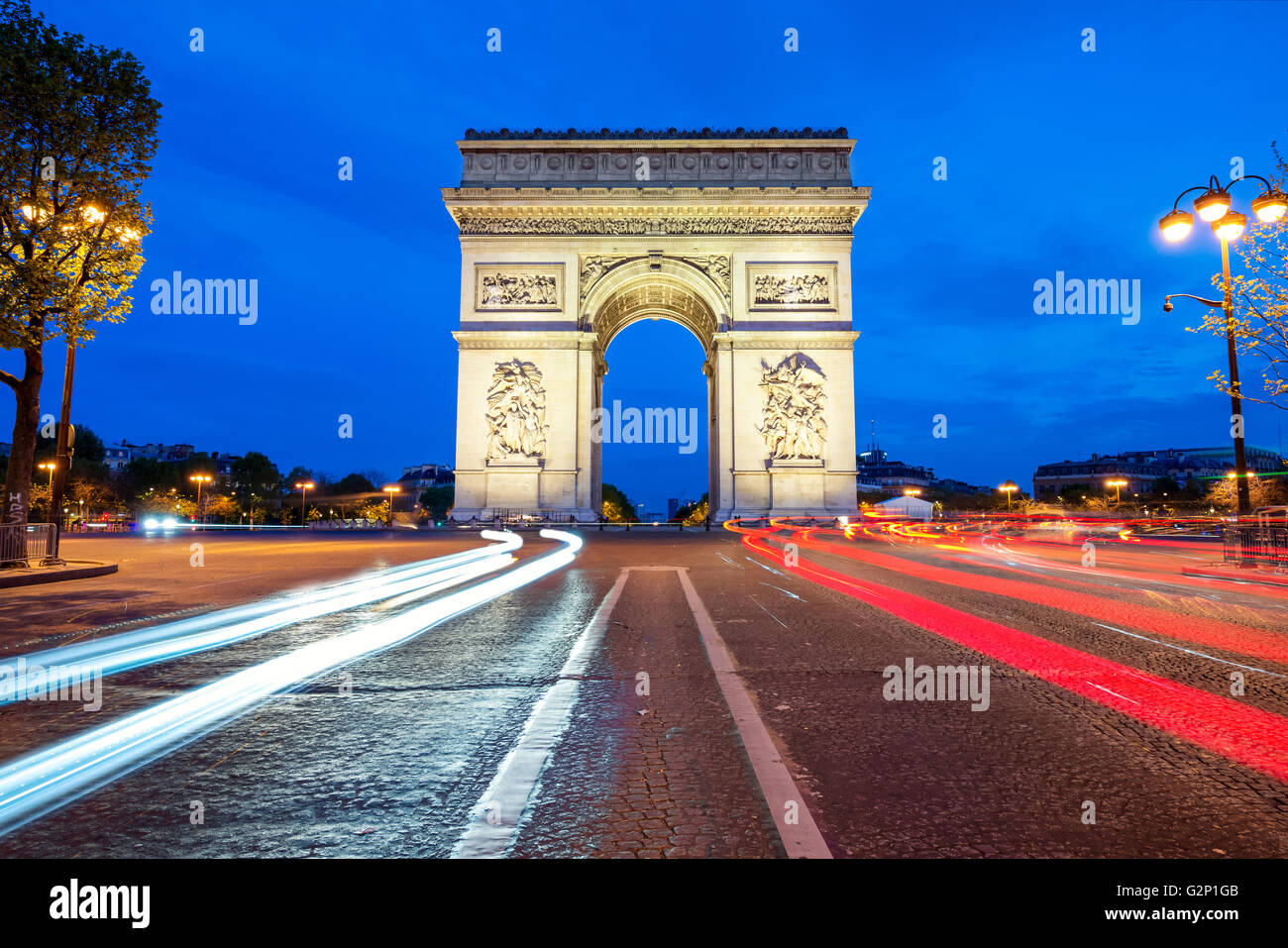 Arc de Triomphe at night in Paris, France - Stock Image