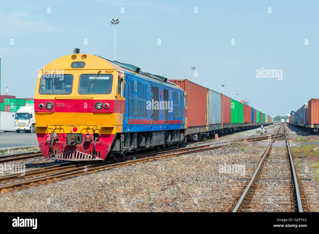 Cargo train platform with freight train container at depot - Stock Image
