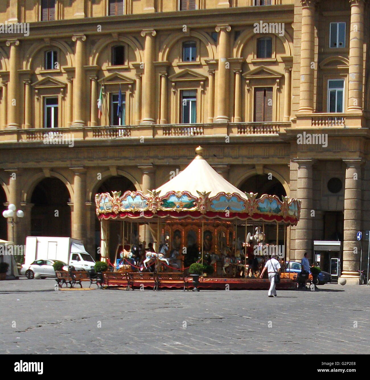 An antique carnival carousel in the middle of a plaza in Florence, Italy. - Stock Image