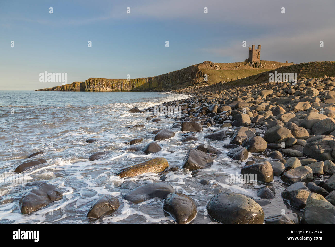 Dunstanburgh Castle on the north east coast of Northumberland, England, UK - Stock Image