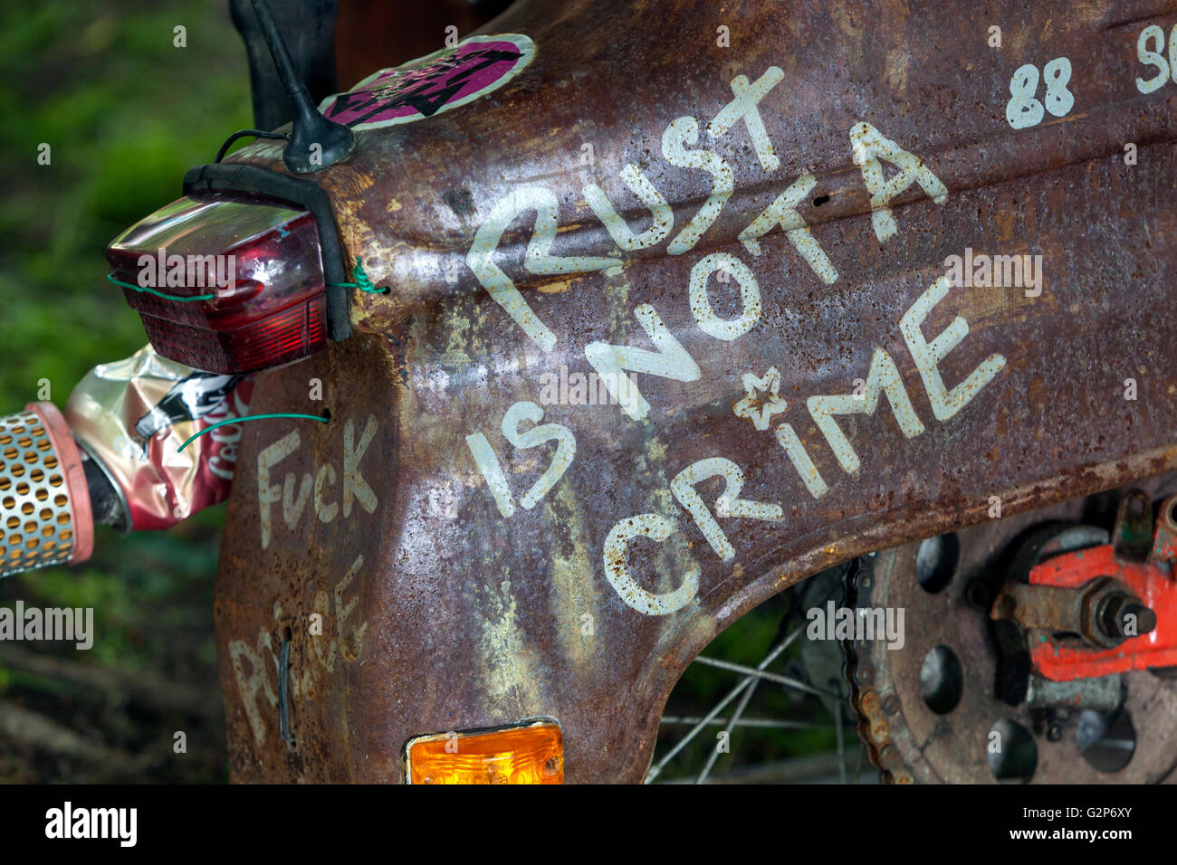 Rust is not a crime, the inscription on a Czech motorcycle Jawa 21 - Stock Image
